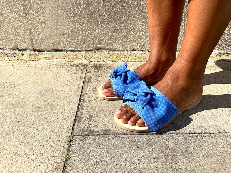 Serafina flat blue gingham leather slide sandals with bow trim by Miss L Fire. L