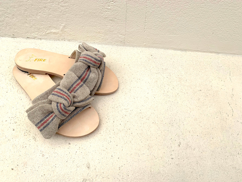 Serafina flat Spanish linen leather sole slide sandals with bow trim by Miss L Fire. Online exclusive.