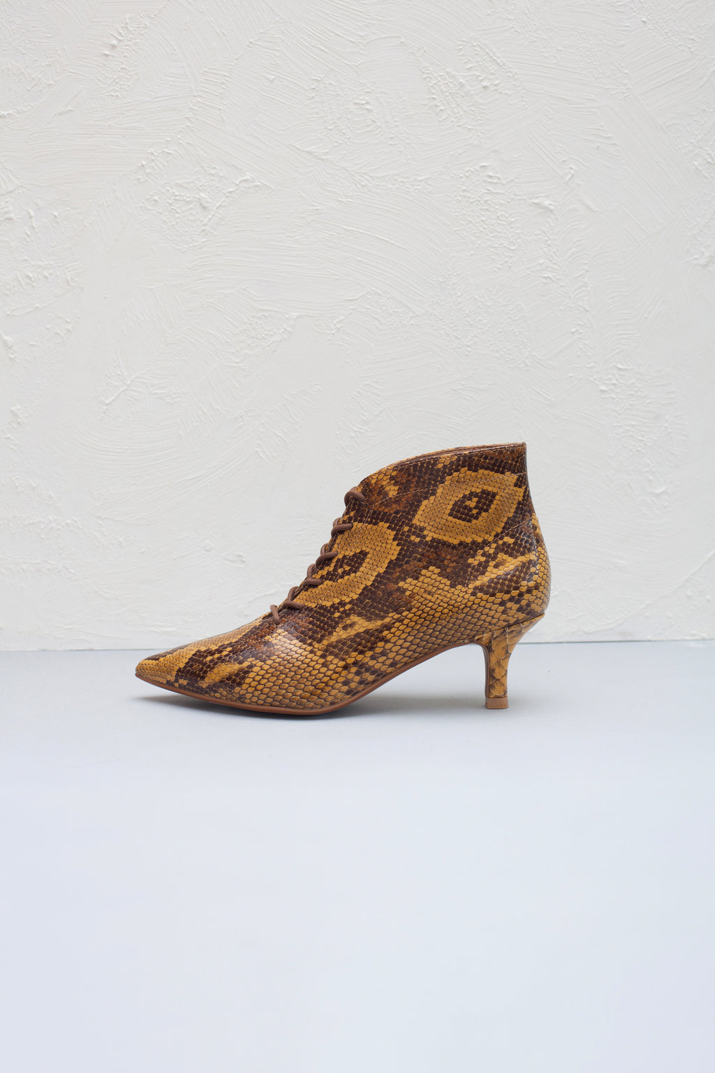 Kitten heel lace up boots in natural snake print leather by Miss L Fire.