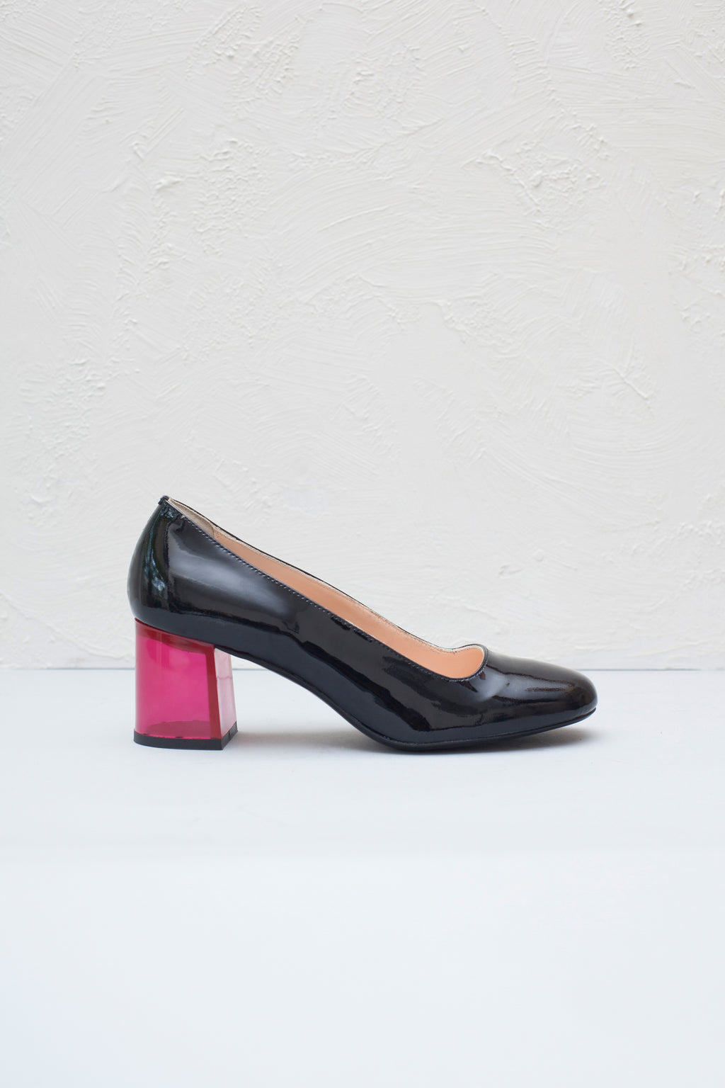 Moneypenny black patent pumps with fuscia pink clear lucite heel. By Miss L Fire. Made in Italy.