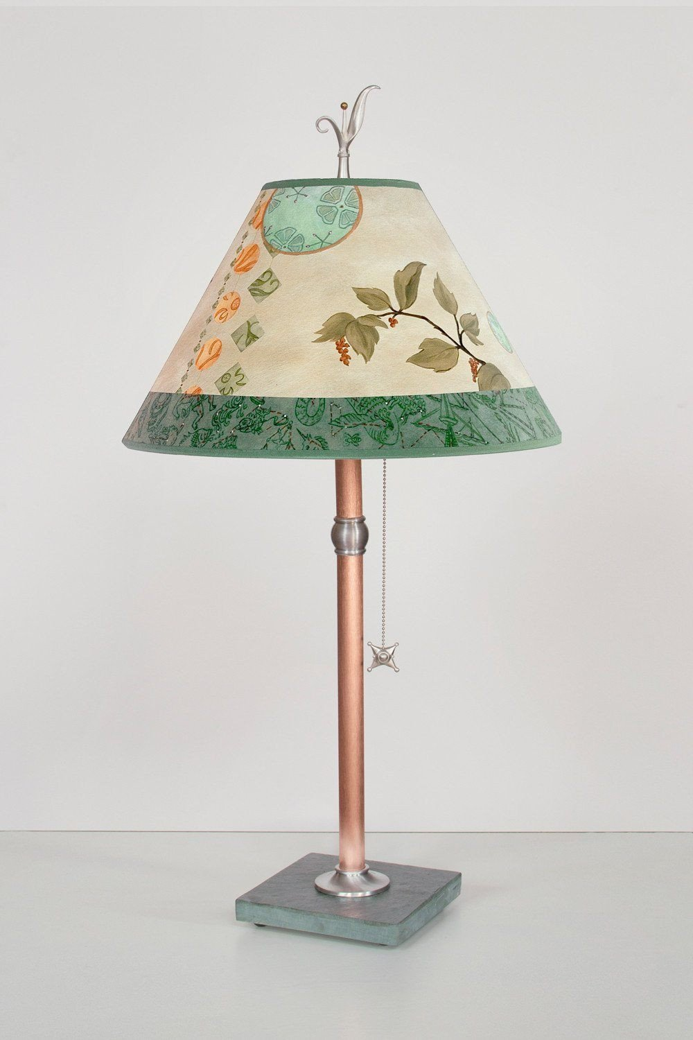 Celestial Leaf medium conical copper table lamp lit