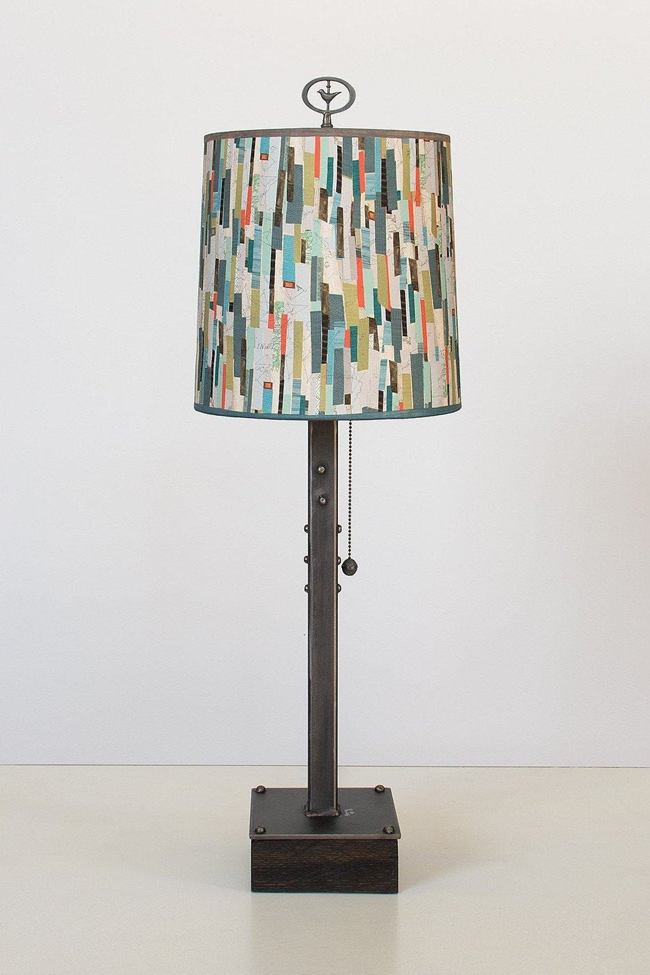 Steel Table Lamp on Wood with Medium Drum Shade in Papers