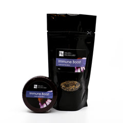 tea blend in black packaging with small tea tin