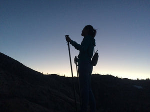 nighttime-earthtrek-trekking-hiking-mountain-trail-stick-with-woman-hiker