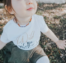 Toddler girl wearing Baltic Amber Teething Necklace in 'Willow'
