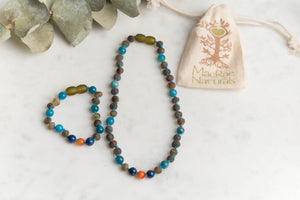 Baltic Amber Teething & Pain Jewelry in 'Cash'