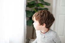 Young Boy wearing Baltic Amber Teething Necklace in 'Maverick'