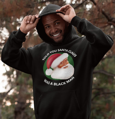 black man outdoors smiling wearing black santa claus is black hoodie