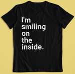 smiling on the inside black tshirt flat lay background