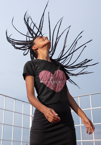 happy woman swinging braids outdoors wearing love simply tshirt