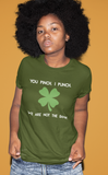 black woman afro wearing not the same green tshirt serious expression