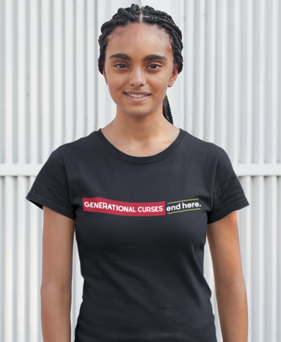 Black woman smiling wearing generational curses tshirt outside