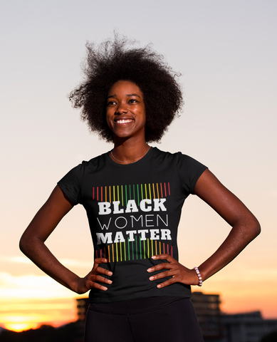 Happy woman smiling outdoors afro hands on hip proud black women matter tshirt