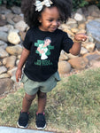 hustle like tiana black shirt smiling girl natural hair outdoors