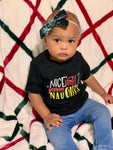 baby girl wearing nice until naughty tee with serious expression