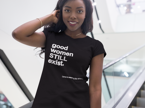 black woman standing outside wearing black good women exist tee