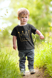Young boy outdoors black tshirt crown