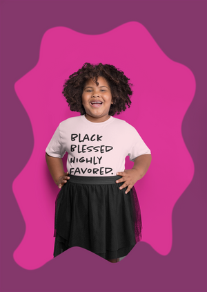 smiling black child natural hair wearing blessed tee and skirt