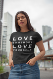 woman standing outside serious face love somebody love yourself black tshirt jean skirt