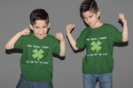 Twin boys wearing not the same st Patrick's day tshirt four leaf clover