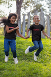 African American children playing outside happy wearing generational wealth tshirt
