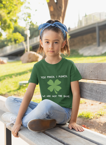 Little girl sitting on bench outdoors wearing not the same tshirt