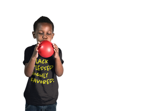 black boy wearing blessed tee and blowing red balloon