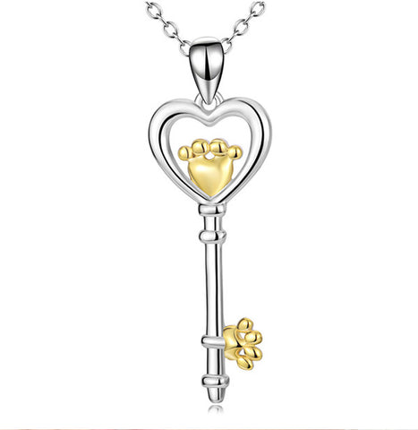S925 silver heart-shaped key necklace with 18 K gold plating on female feet