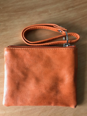 The Little leather pouch - with wrist handle. Fits cards with  internal pockets.