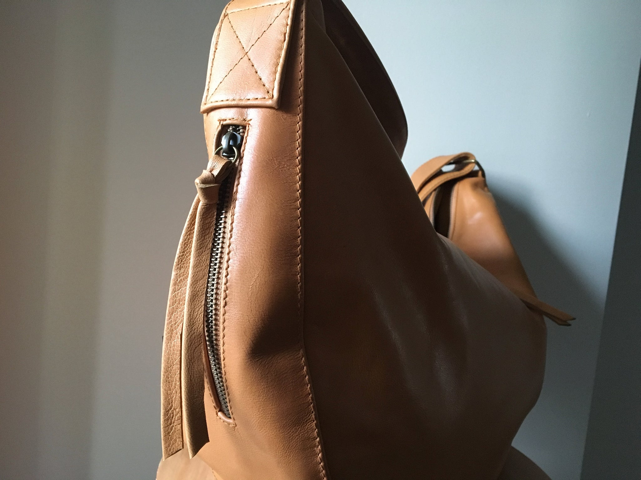 The Bend-Curvy slouchy and soft handmade leather handbag. Crossbody wide strap.