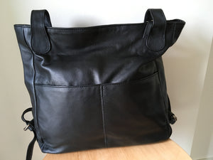 The Holster-Convertible backpack handbag. Handmade from genuine leather.