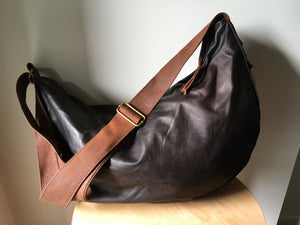 The Bend-Curved, soft and slouchy, handmade leather handbag.