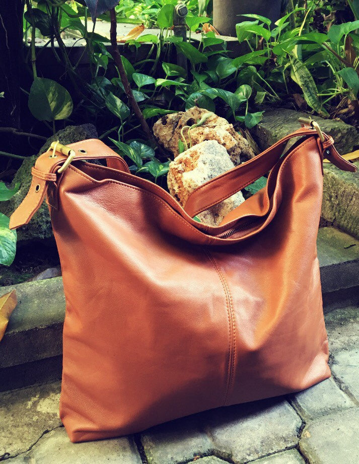 The Verve-Brown Leather shoulder Tote Bag.Single strap with adjustable belt features.