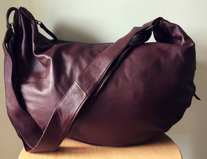 The Bend-Curved, Slouchy, hobo stylish leather shoulder bag Crossbody bag with extra wide strap.