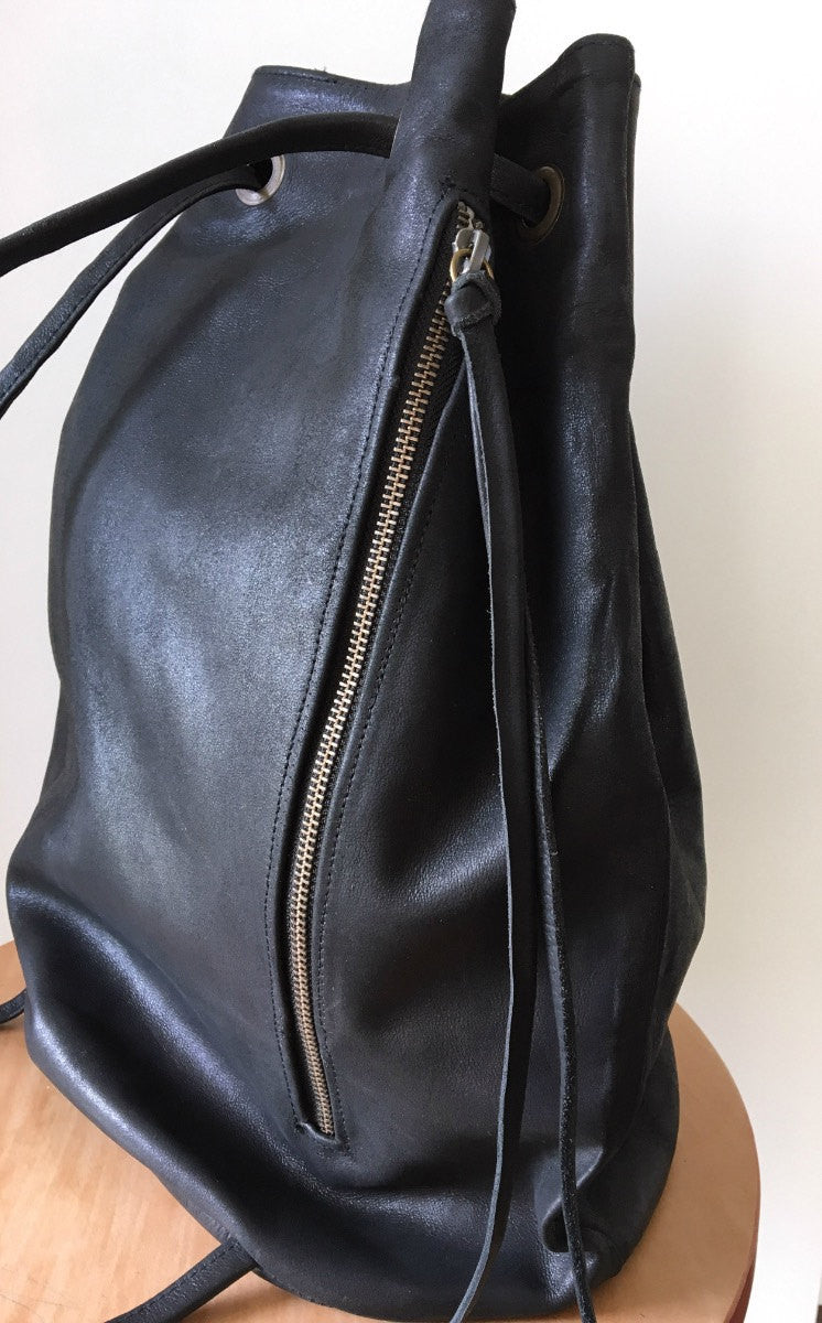 The Barrel-Real leather backpack bag.Barrel bag made from soft leather with zip pocket.