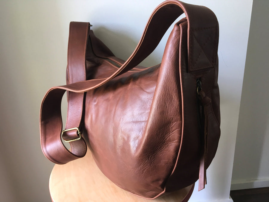The Bend-Curved, soft and slouchy handmade leather handbag.