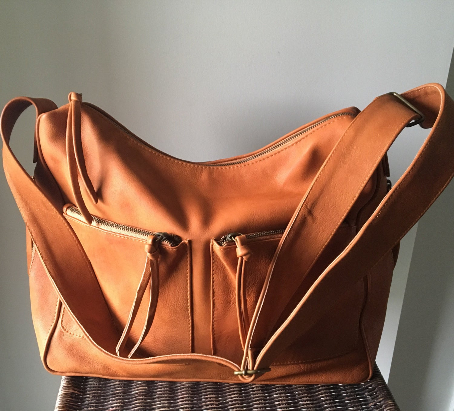 The Sender-Curved, hobo style handmade leather bag.
