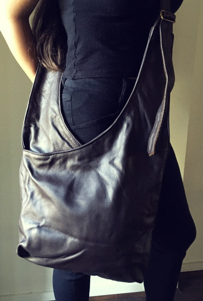 The Cross-Leather crossbody tote, unique, large functional leather tote bag.