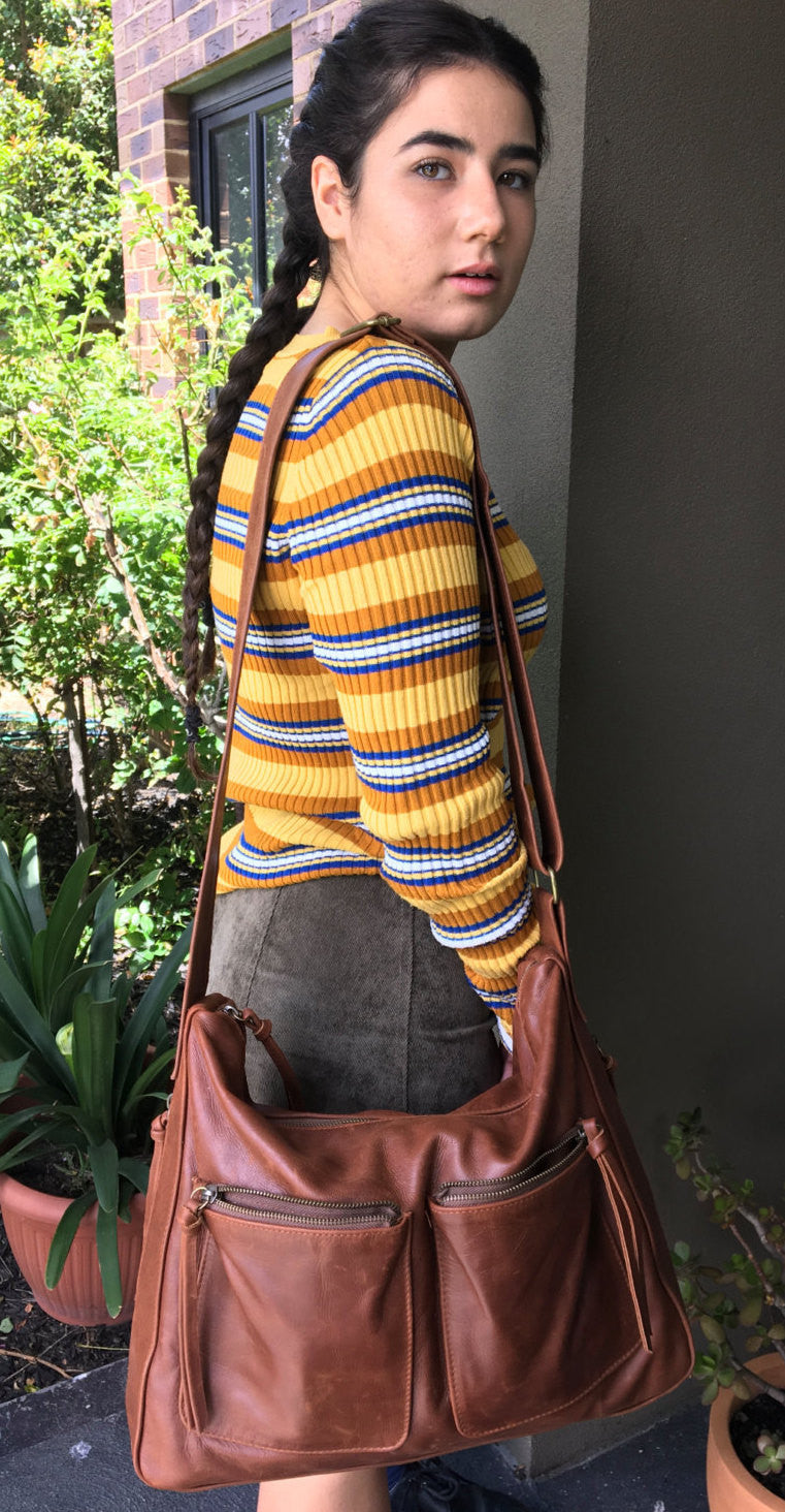 The Sender-Extra wide crossbody strap makes it so comfortable.