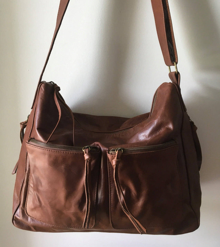 The Sender-Curved hobo style handmade leather bag