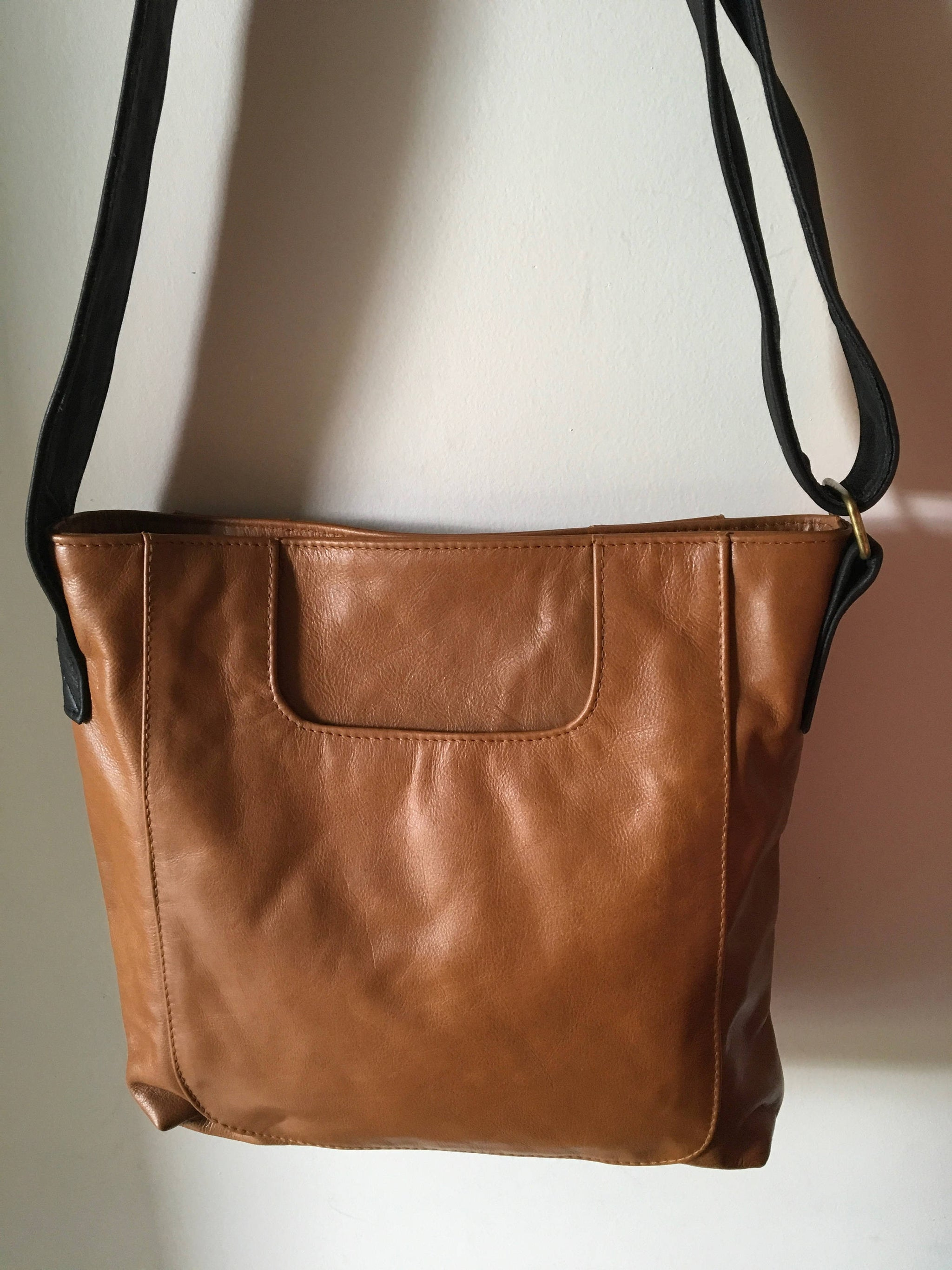 The Edge - Simple,stylish tan leather tote. Classic lines, deep pockets and strong shoulder strap this tan leather tote is the perfect shopping bag