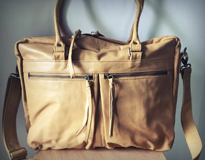 The Cabin-Leather computer work, tote bag. Shoulder strap with ability to open eaily and pockets.