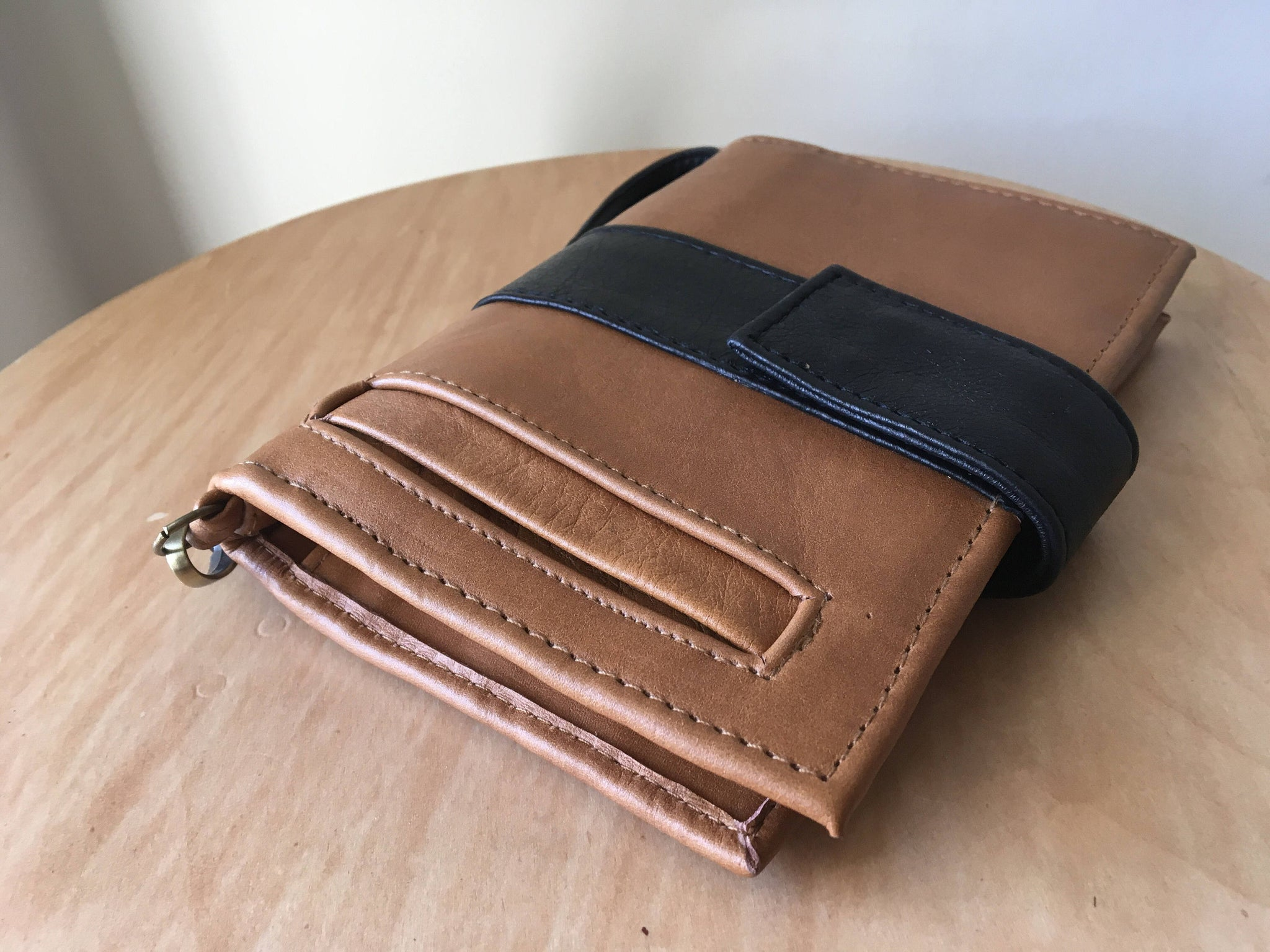 The Equity Wallet -Beautiful luxurious leather phone wallet.Wristlet with 27 card slots, photo windows and pockets. Lots of room. Mini clutch purse