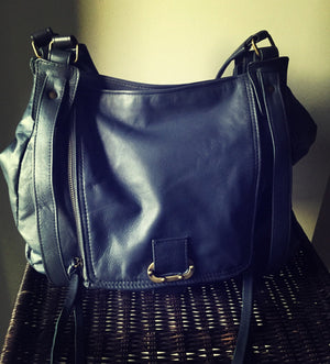 The Pouch - Leather shoulder handbag in genuine lambskin leather. The Pouch bag is a rare design.