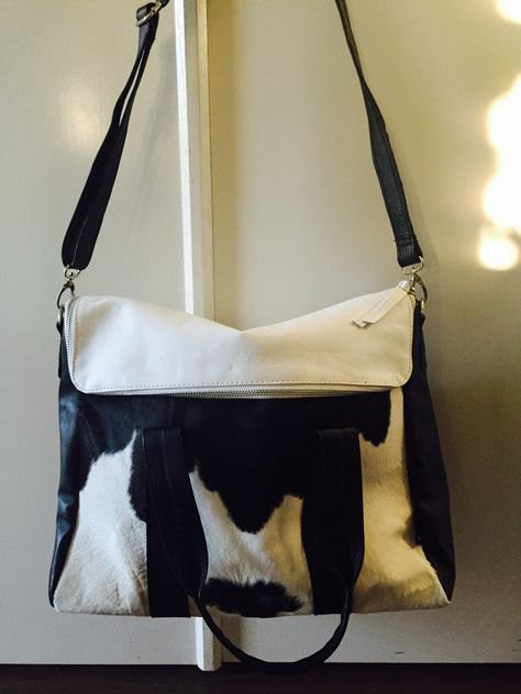 The Highland-Cow hide shoulder bag featuring lambskin leather.
