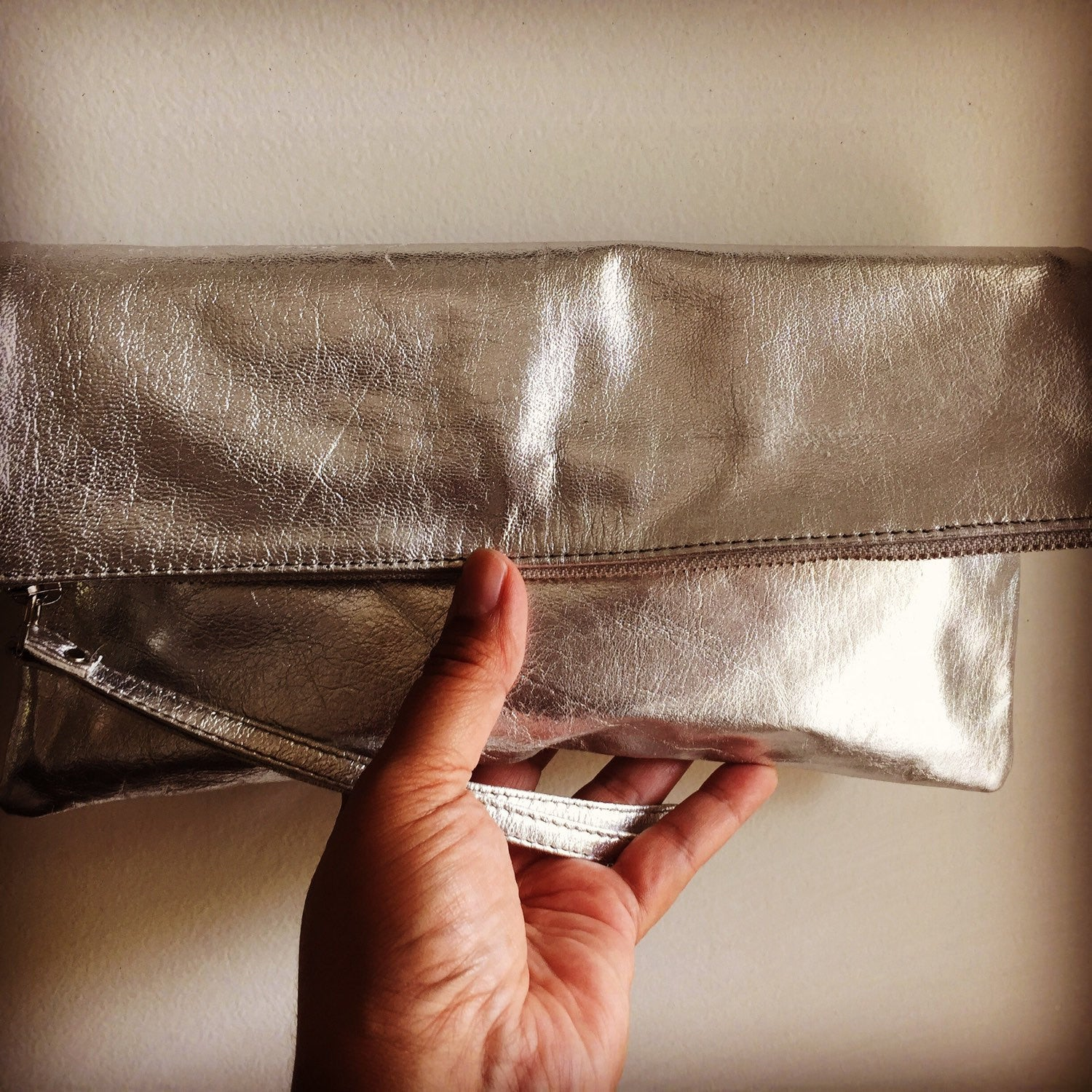 The BiFold Clutch - Shimmery metallic genuine leather clutch.