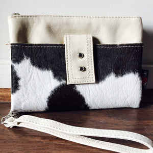 The Double Cow Hide - Beautiful luxurious leather & cow hide wallet.Wristlet and two generous pockets on either side.Lots of room for cards and coins.