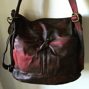 The Bolster-Leather backpack, converting shoulder tote.Genuine leather.