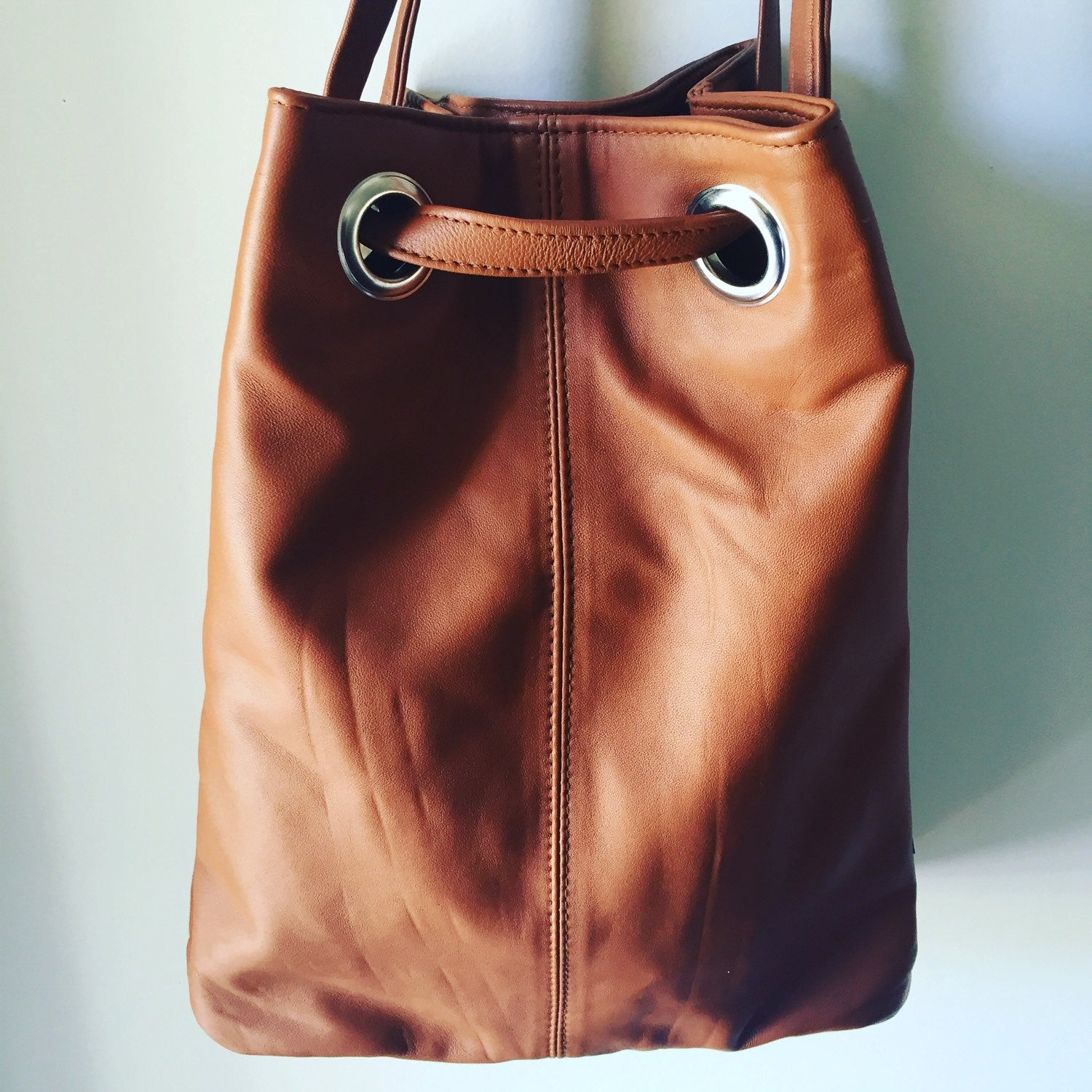 The Glide-Crossbody leather bag.