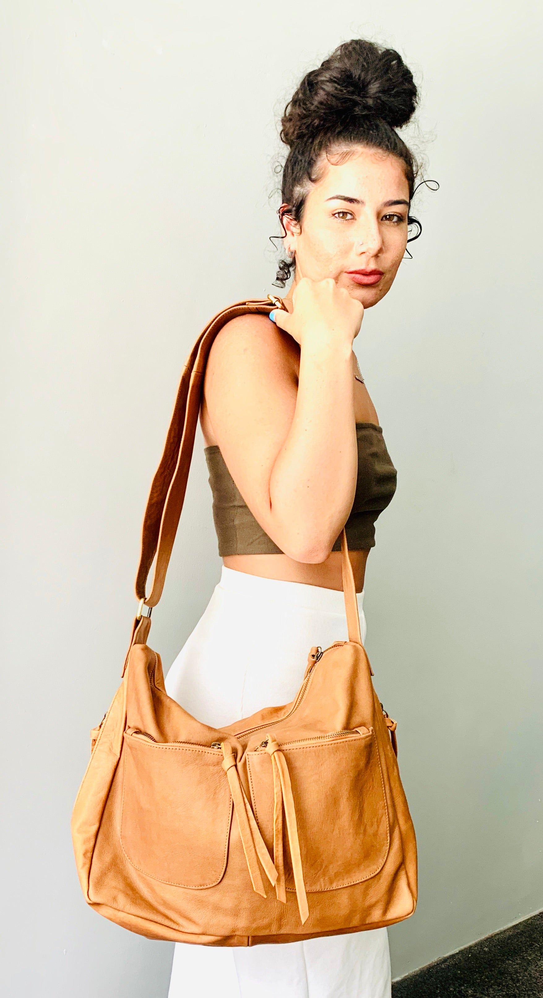 The Sender-Curved hobo style handmade leather bag.
